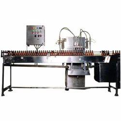 Bottle Filling, Capping & Sealing Machine